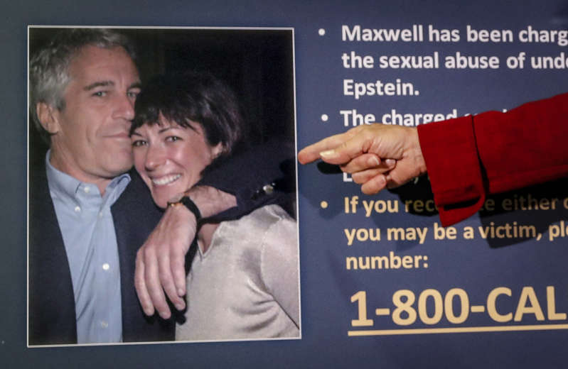 FILE - In this July 2, 2020, file photo, Audrey Strauss, acting U.S. attorney for the Southern District of New York, points to a photo of Jeffrey Epstein and Ghislaine Maxwell during a news conference in New York. Maxwell claims she is being prosecuted on sex abuse charges that could put her in prison for life because Epstein killed himself and prosecutors wanted a substitute to replace him with, lawyers said in newly unsealed court papers. (AP Photo/John Minchillo, File)