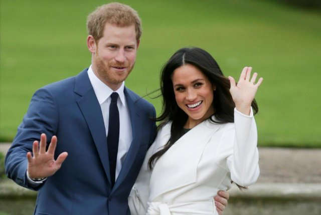 Prince Harry, Meghan Markle that are standing in the grass: Meghan Markle says the British royal family is 'perpetuating falsehoods' about her and her husband, prince Harry Photo: AFP / Daniel LEAL-OLIVAS