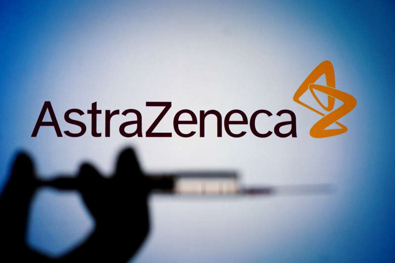 File: The AstraZeneca logo is seen with a hand holding a syringe and needle in this photo illustration in Warsaw, Poland on March 1, 2021. People in France aged over 65 with existing health problems can be given the AstraZeneca COVID-19 vaccine, France's health minister said on Monday departing from Paris's earlier stance that the vaccine should be for under-65s only. (Photo by Jaap Arriens/NurPhoto via Getty Images)