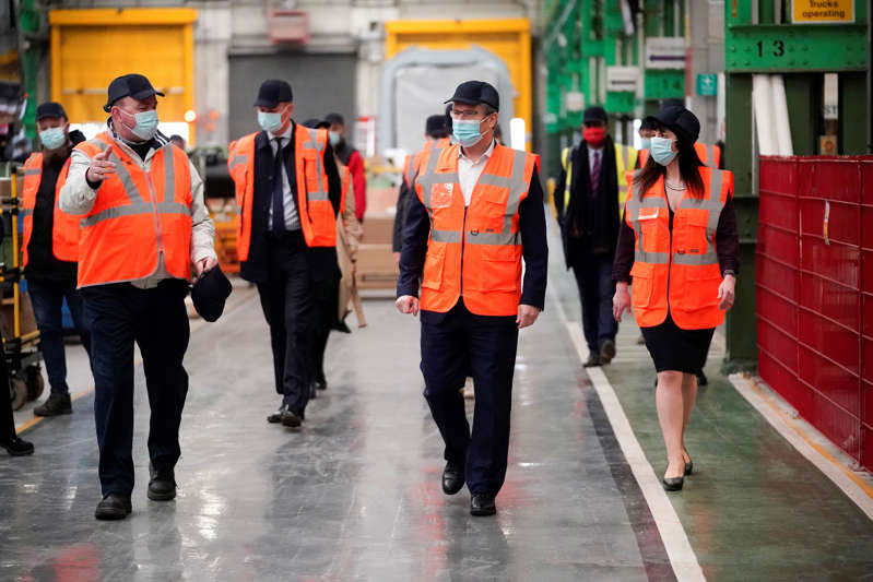 File: British leader of the Labour Party, Sir Keir Starmer (centre) tours Alstom, formerly Bombardier, train manufacturers during a post-budget visit on March 04, 2021 in Derby, England. (Photo by Christopher Furlong/Getty Images)