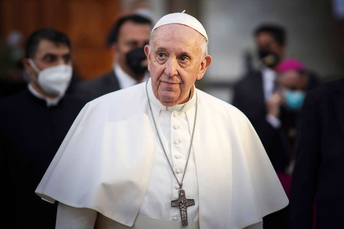 Pope Francis looking at the camera: AYMAN HENNA/AFP via Getty Pope Francis