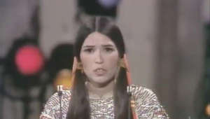 "Sacheen Littlefeather refuses to accept the Best Actor Oscar® on behalf of Marlon Brando for his performance in ""The Godfather"" at the 45th annual Academy Awards® in 1973. Liv Ullmann and Roger Moore presented the award."