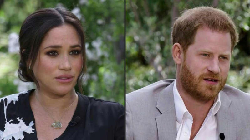 Meghan Markle, Prince Harry smiling for the camera: Meghan Markle and Prince Harry