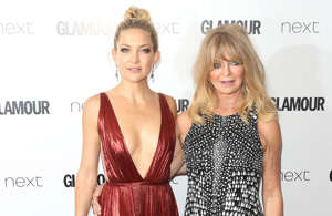 """Kate Hudson, Goldie Hawn are posing for a picture: The 'Mother's Day' actress Kate Hudson is the daughter of Goldie Hawn.  Goldie has remained a Hollywood mainstay since winning an Oscar for her role in 'Cactus Flower.' The stars stepfather is also famous actor Kurt Russell. Kate first broke onto the scene with her role as a seasoned groupie in the film 'Almost Famous', earning herself an Oscar nod.  Kate previously said in an interview: """"There's a misconception that if you come from famous parents, you're seeking fame for the sake of fame, I see it as the opposite: Growing up with parents who were in the spotlight-it was almost like, wow, if I didn't love to create characters, I would run as far away from fame as I could get."""