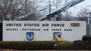 a sign in front of a building: Wright-Patterson Air Force Base Gate 12-A (FILE PHOTO)