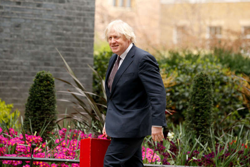LONDON, UNITED KINGDOM - MARCH 25: British Prime Minister Boris Johnson walks up Downing Street in London, United Kingdom on March 25, 2021. Members of Parliament debate and vote later today on a six-month renewal of the wide-ranging government powers contained in the Coronavirus Act. (Photo by David Cliff/Anadolu Agency via Getty Images)