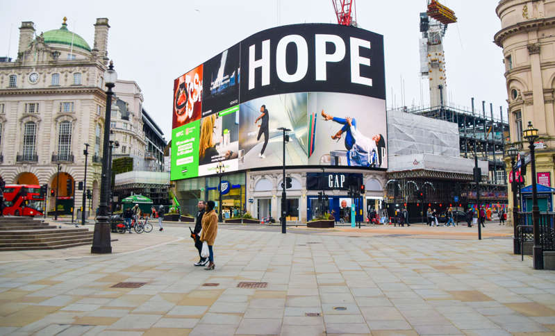 LONDON, UNITED KINGDOM - 2021/03/26: The message Hope is displayed in a quiet Piccadilly Circus, with London still under lockdown.  The Stay At Home order is set to end on 29th March. (Photo by Vuk Valcic/SOPA Images/LightRocket via Getty Images)