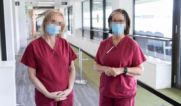 a person standing in front of a window: Staff at the vaccine centre at Pairc Ui Chaoimh had to deal with a 'large group' of pharmacists who wanted to be vaccinated. Pic Darragh Kane