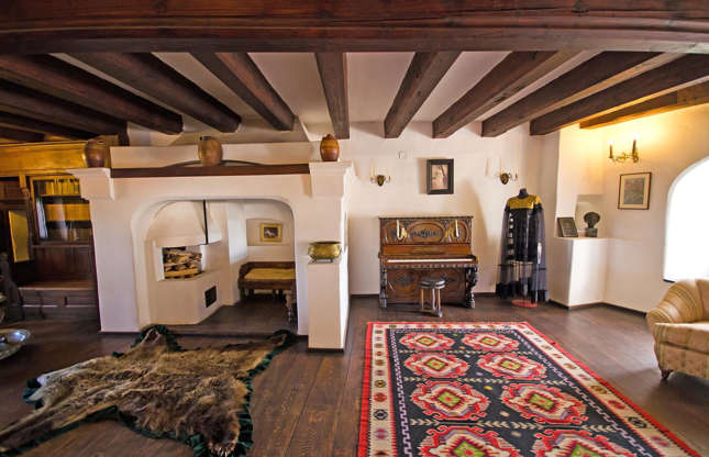 Slide 3 of 75: Bran Castle is now used to exhibit furniture and artefacts collected by Romania's late Queen Maria. However, in 2016 two vampire fans became the first people to spend the night in Bran Castle after winning an Airbnb competition. The Canadian siblings slept in velvet-lined coffins and despite some people's fears, they survived the night.