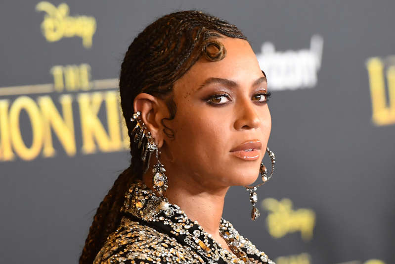 """Beyonce looking at the camera: (FILES) In this file photo taken on July 9, 2019, US singer/songwriter Beyonce arrives for the world premiere of Disney's """"The Lion King"""" at the Dolby theatre in Hollywood. - The Bey Hive was feeling the love on July 19, 2019, over Beyonce's release of the album """"The Lion King: The Gift,"""" which the pop queen dropped as a sister piece to the new Disney film she stars in. Beyonce dubbed the 27-track album she curated and produced """"a love letter to Africa,"""" enlisting several African artists as well as a star-studded cast including her husband Jay-Z, Kendrick Lamar, Childish Gambino, Pharrell and Tierra Whack -- along with none other than Jay and Bey's 7-year-old daughter Blue Ivy Carter -- as collaborators. (Photo by Robyn Beck / AFP)ROBYN BECK/AFP/Getty Images ORG XMIT: Beyonce r ORIG FILE ID: AFP_1IX9ZL"""