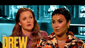 Drew Barrymore, Demi Lovato looking at the camera: @Demi Lovato sits down with Drew for an emotional interview to discuss the reality of growing up in the spotlight starting at a young age, and the unfair treatment of celebrities sometimes by the press.  #DrewBarrymoreShow #DemiLovato #DancingWithTheDevil  Subscribe to The Drew Barrymore Show: https://www.youtube.com/channel/UCWIj8e2_-uK1m886ADSYO6g?sub_confirmation=1  Keep the party going with a visit to https://thedrewbarrymoreshow.com  FOLLOW THE DREW BARRYMORE SHOW  Instagram: https://www.instagram.com/thedrewbarrymoreshow Twitter: https://twitter.com/DrewBarrymoreTV Facebook: https://www.facebook.com/TheDrewBarrymoreShow Pinterest: https://www.pinterest.com/thedrewbarrymoreshow Snapchat: https://www.snapchat.com/add/drewbarrymoretv TikTok: https://www.tiktok.com/@thedrewbarrymoreshow  FOLLOW DREW BARRYMORE  Instagram: https://www.instagram.com/drewbarrymoreshow Twitter: https://twitter.com/DrewBarrymore Facebook: https://www.facebook.com/DrewBarrymore Pinterest: https://www.pinterest.com/drewbarrymoreshow  The Drew Barrymore Show is daytime's brightest destination for intelligent optimism and maximum fun, featuring everyone's favorite actor, businessperson, mom and cultural icon, Drew Barrymore! From news to pop culture, human interest to comedy - you'll discover it here with Drew along with the beauty and wisdom, as well as the heart and humor in life.  Demi Lovato and Drew Get Honest About Difficulties of Growing Up as Child Stars http://www.youtube.com/thedrewbarrymoreshow