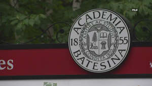 a sign on the side of the street: Bates college sees spike in Covid-19 cases