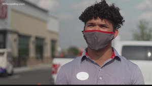 a man wearing sunglasses and standing in front of a building: Riverview Chick-fil-A team member jumps into action to help coworkers caught in storm