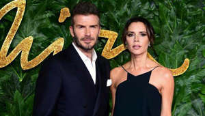David Beckham, Victoria Beckham posing for the camera