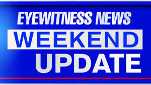 a blue sign sitting on the side: Eyewitness News Weekend Update