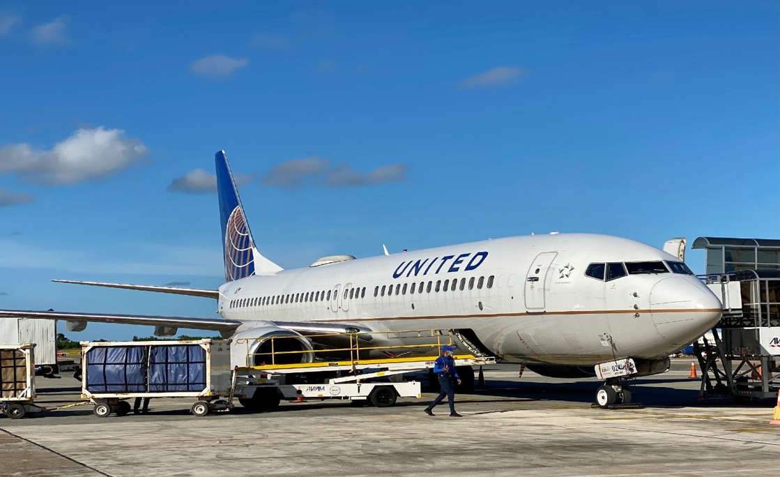 a large passenger jet sitting on top of a tarmac: united airlines diversity women people of color black lives matter women people of color commercial pilot