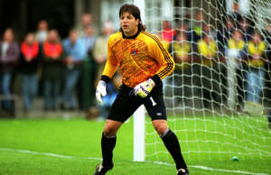 Tony Meola with a football ball on a field: There are countless stories of multi-talented athletes who excelled in several sports, but only a relative handful actually possessed the ability to go pro in more than one. Sports history itself would look very different if some of the following stars elected to go in another direction, but we're glad they chose the path that made them the household names they are-and we suspect they are, as well.