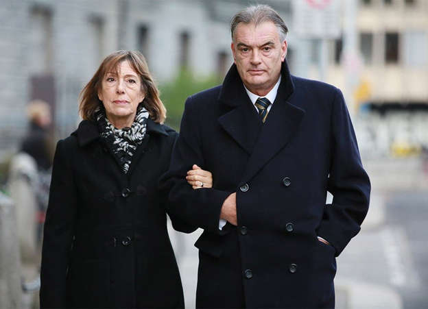 Ian Bailey wearing a suit and tie standing next to a woman: Ian Bailey and Jules Thomas. Pic: Collins Courts.