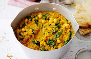 a bowl of food on a plate: A quick and tasty dhal to keep away the chillTesco Real Food