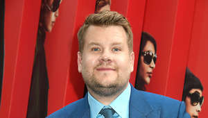 James Corden wearing a suit and tie