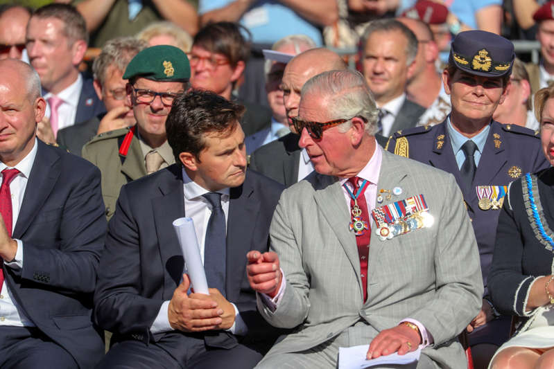 The Prince of Wales talks with Minister for Defence People and Veterans Johnny Mercer during the Polish Airborne Commemorative Service in Driel, Netherlands, during the commemorations for the 75th anniversary of the military operation in Arnhem, codenamed Operation Market Garden, made famous in the film A Bridge Too Far. (Photo by Steve Parsons/PA Images via Getty Images)