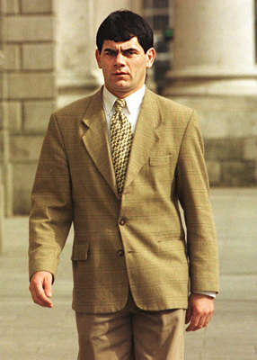 Gerry Hutch wearing a suit and tie: Gerry Hutch denied he had accumulated his IR£4million wealth from a raid on a Securicor van at Marino Mart in 1987 and later from a robbery of Brinks Allied's headquarters in Clonshaugh, Dublin, in 1995. Pic: Collins Dublin