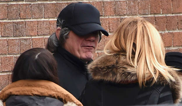 a person standing in front of a brick building: Gerry Hutch in disguise – Hutch's brother, Eddie, three of his nephews and two of his best friends were all murdered. Pic: REUTERS
