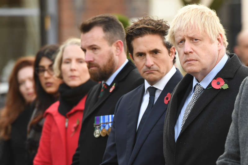 Prime Minister Boris Johnson (right) and Defence Minister Johnny Mercer (centre) during a service at the cenotaph in St Peter's Square, Wolverhampton, to mark Armistice Day, the anniversary of the end of the First World War. (Photo by Stefan Rousseau/PA Images via Getty Images)