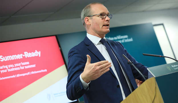 Simon Coveney wearing a suit and tie: Simon Coveney has been getting behind England for Euro 2020. Pic: JULIEN BEHAL PHOTOGRAPHY