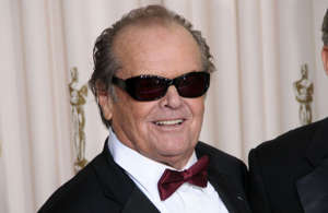 Jack Nicholson wearing a suit and sunglasses posing for the camera: Happy Birthday, Jack Nicholson! The legendary actor turns 84 on April 22, 2021, and to celebrate we take a look back at some of the show-stopping performances that have earned him 12 Academy Award nominations and six Golden Globes over his 60-year career.  Here are Nicholson's top 10 greatest films of all time...