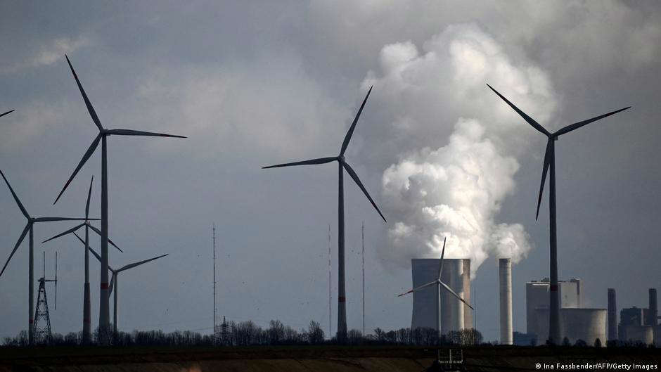 a windmill on a cloudy day: Emerging markets investing in renewable energy may be able to avoid stranded assets like coal plants that are unprofitable to run