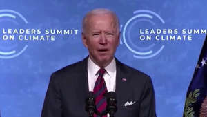 Joe Biden wearing a suit and tie: Joe Biden struggles to pronounce 'Glasgow' at summit