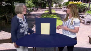a woman sitting on a table: Antiques Roadshow: Elvis Presley autograph valued by expert