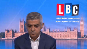 Sadiq Khan wearing a suit and tie: Sadiq Khan quizzed by pensioner on future of free bus passes
