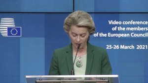 Ursula von der Leyen standing in front of a computer screen: AstraZeneca 'has to catch up' says Ursula von der Leyen