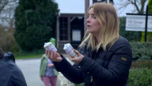 a person talking on a cell phone: Emmerdale: Charity gives Lydia money to pay off Paul's debt