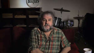Fran Walsh sitting at a table: The Beatles: Get Back preview released by Peter Jackson