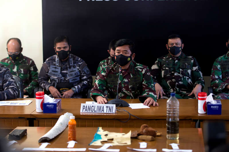 Indonesian Military chief Hadi Tjahjanto, center, talks to media as they display debris found in the waters during a search for The Indonesian Navy submarine KRI Nanggala at Ngurah Rai Military Air Base in Bali, Indonesia on Saturday, April 24, 2021. Indonesia's navy on Saturday said items were found from a missing submarine, indicating the vessel with 53 crew members had sank and there was no hope of finding survivors.