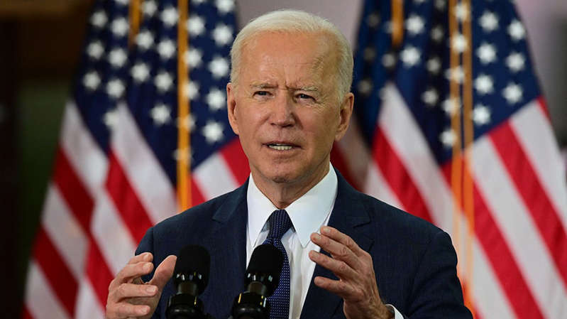Joe Biden wearing a suit and tie: Powered by Microsoft News