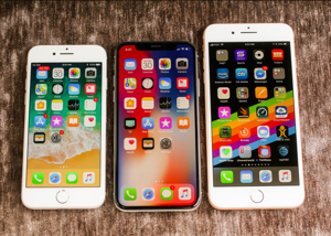 graphical user interface, application: The iPhone X (center), launched in 2017 alongside the iPhone 8 (left) and iPhone 8 Plus (right). Sarah Tew/CNET