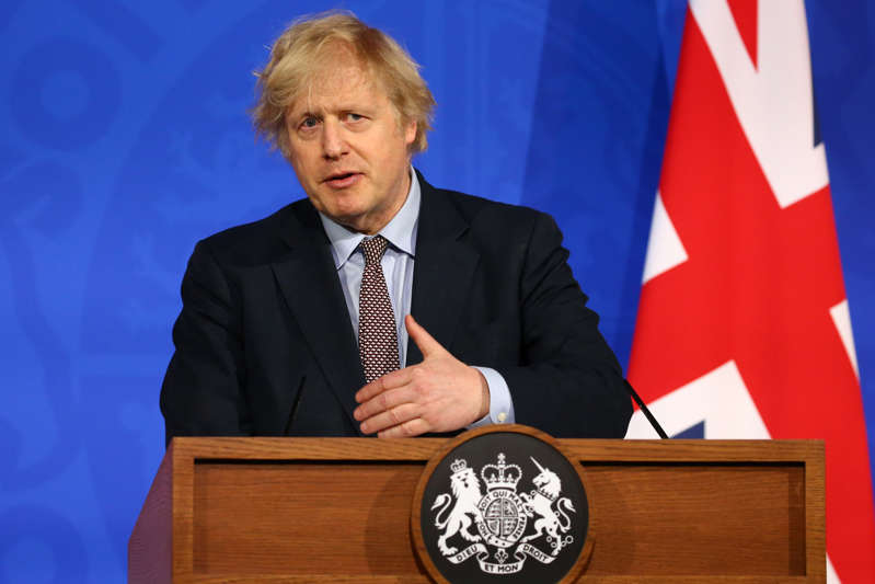 LONDON, ENGLAND - MARCH 29: Britain's Prime Minister, Boris Johnson gives an update on the coronavirus Covid-19 pandemic during a virtual press conference in the new £2.6million No9 briefing room on March 29, 2021 in London, England.  (Photo by Hollie Adams - WPA Pool/Getty Images)