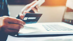 a close up of a person using a laptop: Travel and rewards credit cards draw in customers by adding bonus points and rewards for spending in various categories, such as airfare, hotels and restaurants. During the pandemic, spending in these categories dropped dramatically, forcing the credit card companies to make changes in order to encourage spending. For some customers, the additional points now granted in categories more attuned to pandemic spending patterns made the value of these cards jump tremendously. Read: 10 Credit Cards To Consider for Travel Rewards While you shouldn't increase or change your spending habits just to earn additional credit card points, if you're already spending in these categories, these cards can provide additional benefits. Here's a look at 10 cards that have gotten better for consumers during the pandemic.  Last updated: April 6, 2021