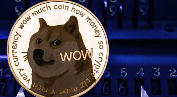 graphical user interface, website, calendar: A concept image of Dogecoin (DOGE) with the Shiba Inu and text on a gold token.