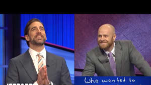 a screen shot of Aaron Rodgers in a suit and tie: Were you wondering what Aaron Rodgers' response was to the one football question on everyone's mind? Watch what happened after the show in the exclusive postgame chat at the end of today's Final Jeopardy!  Remember 2021's NFC Championship Game when Green Bay lost to Tampa by 5 points? So does Jeopardy! guest host Aaron Rodgers. And our 2-day champion Scott won't let him forget in this fun round of Final Jeopardy!   Final Jeopardy! 04/05/2021 | April 5, 2021  Subscribe to Jeopardy! for exclusive content: http://bit.ly/JSubscribe_YT   The official home for video from Jeopardy! and Jeopardy.com. Subscribe for the best-of-Jeopardy! moments, big wins, great gameplay, and behind-the-scenes snippets.   Want to be on the show? It all starts with the Jeopardy! Anytime Test!  Take the Jeopardy! Test here: http://bit.ly/Jeopardy-Test  Connect with Jeopardy!: Facebook: http://bit.ly/2AuJ6kX  Twitter: http://bit.ly/2kjdBq8  Instagram: http://bit.ly/2AKTpnq  Website: https://www.jeopardy.com/  #Jeopardy!   More Jeopardy!: Find Your Station: http://bit.ly/2BIOtxc  Play J!6: http://bit.ly/2AtJVdT Play Jeopardy! World Tour on Google Play: https://t.co/J2P6b0JLdT  Play Jeopardy! World Tour on iTunes: http://apple.co/2ASWeU1 Play Jeopardy! on Drivetime: http://bit.ly/Download-Drivetime