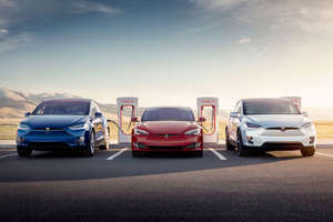 a car parked in a parking lot: More marques than just Tesla may soon be welcome at your local Supercharger station. Tesla