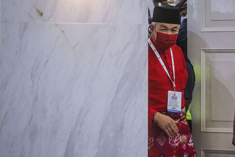 a person wearing a costume: Umno president Datuk Seri Ahmad Zahid Hamidi is pictured at the 2020 Umno annual general meeting in Kuala Lumpur March 28, 2021. ― Picture by Hari Anggara