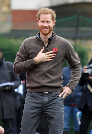 Prince Harry talking on a cell phone