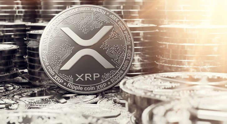 A concept token for XRP (XRP) with stacks of tokens in the background.