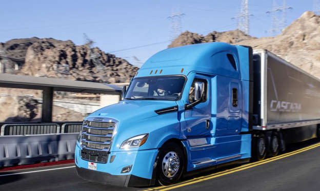 a blue truck parked on the side of a road: At CES Daimler announced that the Cascadia big rig would come standard with Detroit Assurance 5.0, a suite of level 2 advanced driver's aids.