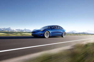 a car parked on the side of a road: This is not an autonomous vehicle. Tesla